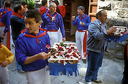 Gubbio 15 MAY 2004..Festival of the Ceri..The parade the ceraioli of St George  whit the little bunches of flower....http://www.ceri.it/ceri_eng/index.htm..