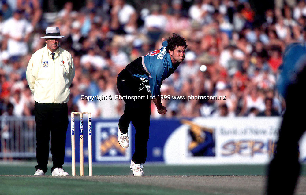 Chris Cairns bowls during the cricket ODI between New Zealand and India, January, 1999. Photo: PHOTOSPORT *** Local Caption ***