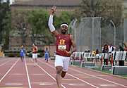 """Eric Allen Jr. celebrates with """"Fight On"""" sign after running the anchor leg on the Southern California Trojans 4 x 100m relay that won in 39.34 against UCLA during an NCAA college dual meet in Los Angeles, Sunday, April 28, 2019."""