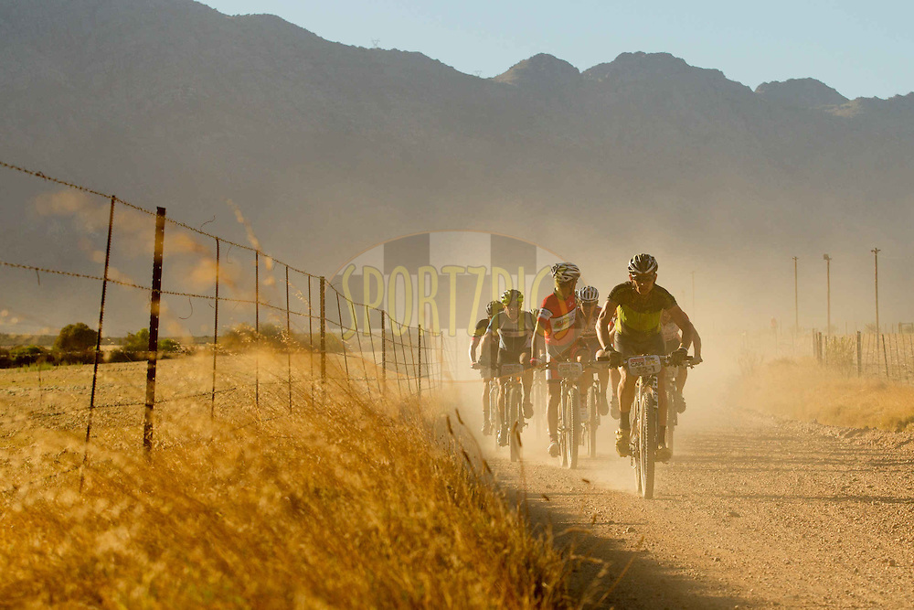 Philip Wong of the United States of America leads a group during stage 2 of the 2013 Absa Cape Epic Mountain Bike stage race from Citrusdal to Saronsberg Wine Estate in Tulbagh, South Africa on the 19 March 2013..Photo by Greg Beadle/Cape Epic/SPORTZPICS
