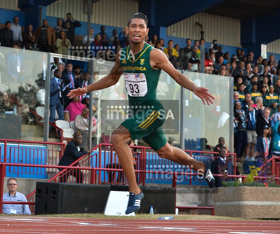 DURBAN, SOUTH AFRICA - JUNE 26: Wayde van Niekerk wins the mens 200m during the afternoon session on day 5 of the CAA 20th African Senior Championships at Kings Park Athletic stadium on June 26, 2016 in Durban, South Africa. (Photo by Roger Sedres/Gallo Images)
