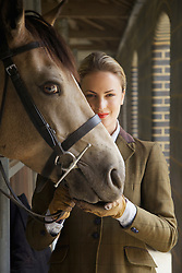 Woman in Riding Outfit with Horse