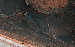 July 6, 2018 - Mars Surface - Image Released Today: One of the most actively changing areas on Mars are the steep edges of the North Polar layered deposits. This image from NASA's Mars Reconnaissance Orbiter (MRO) shows many new ice blocks compared to an earlier image in December 2006. An animation shows one example, where a section of ice cliff collapsed. The older image (acquired in bin-2 mode) is not as sharp as the newer one. HiRISE has been re-imaging regions first photographed in 2006 through 2007, six Mars years ago. This long baseline allows us to see large, rare changes as well as many smaller changes. (Credit Image: © JPL-Caltech/NASA via ZUMA Wire/ZUMAPRESS.com)