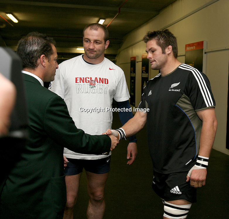 Richie McCaw shakes referee Jonathan Kaplan's hand with England Captain Steve Borthwick (centre) at the coin toss. Iveco test match series, All Blacks beat England 44-12, 2nd Test, AMI Stadium, Christchurch, Saturday 14 June 2008. Photo: Marc Weakley/PHOTOSPORT