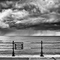 Sign 'Danger From Heavy Seas' on the seafront at Scarborough, North Yorkshire, England