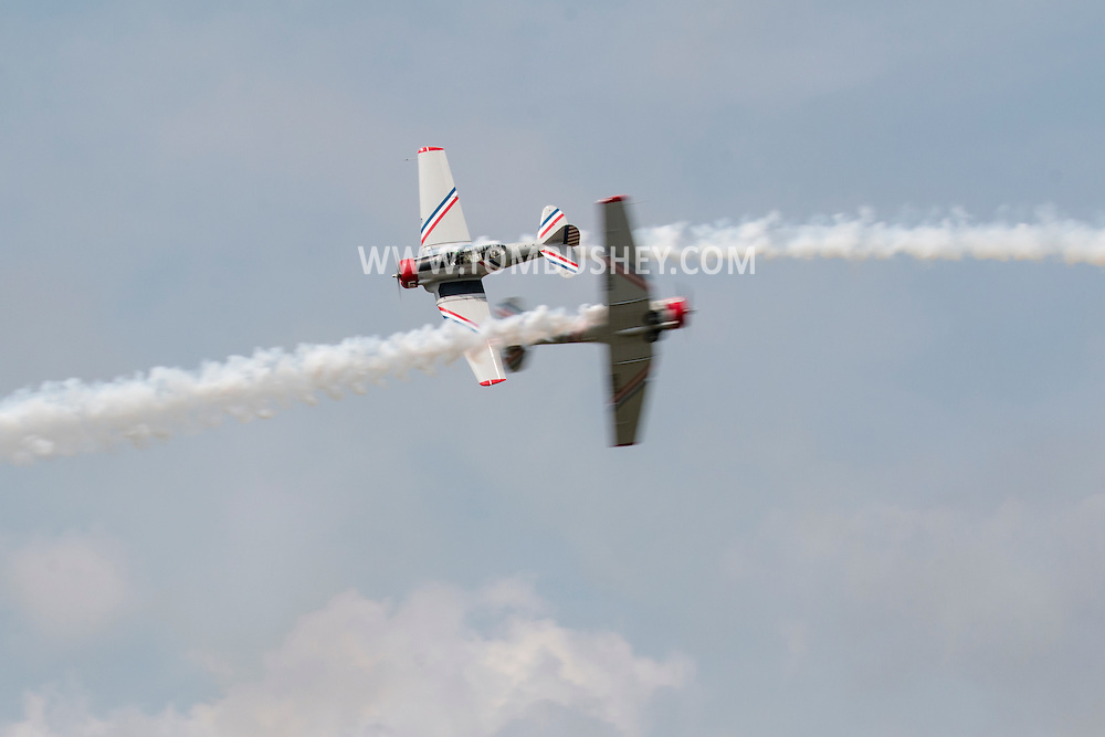 New Windsor, New York - The Geico Skytypers perform at the New York Air Show at Stewart International Airport on Aug. 29, 2015. The planes are vintage World War II SNJ-2 models.