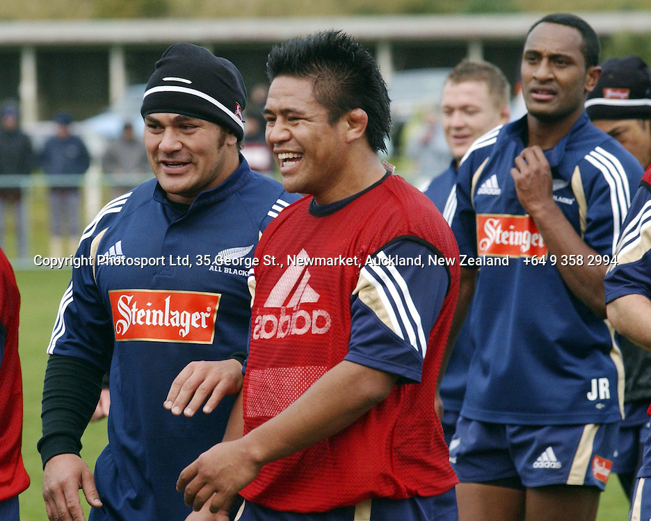 Kess Meeuws and Keven Mealamu share a joke during an All Black Training, 07 June 2004 in Dunedin, prior to the Test match against England on Saturday.<br />