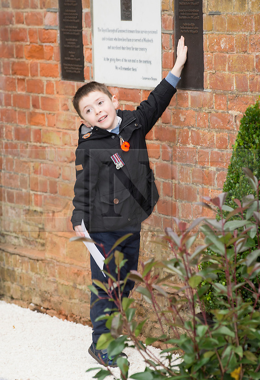© London News Pictures. Jack Rigby, son of Fusilier Lee Rigby at the new memorial in St George's Chapel, Woolwich. A new memorial in St George's Chapel to those from the Borough who lost their lives in Service since the end of WW2.  Fusilier Rigby is one of eleven men named on the memorial in the ruins of the Royal Artillery Garrison Church. Photo credit: Rupert Frere/LNP