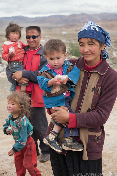 A family outside their home in Bayan-Ölgii Province, western Mongolia.