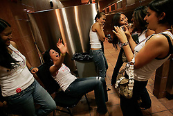Patrons react after  a male striptease, Friday, July 30, 2006 in New York.