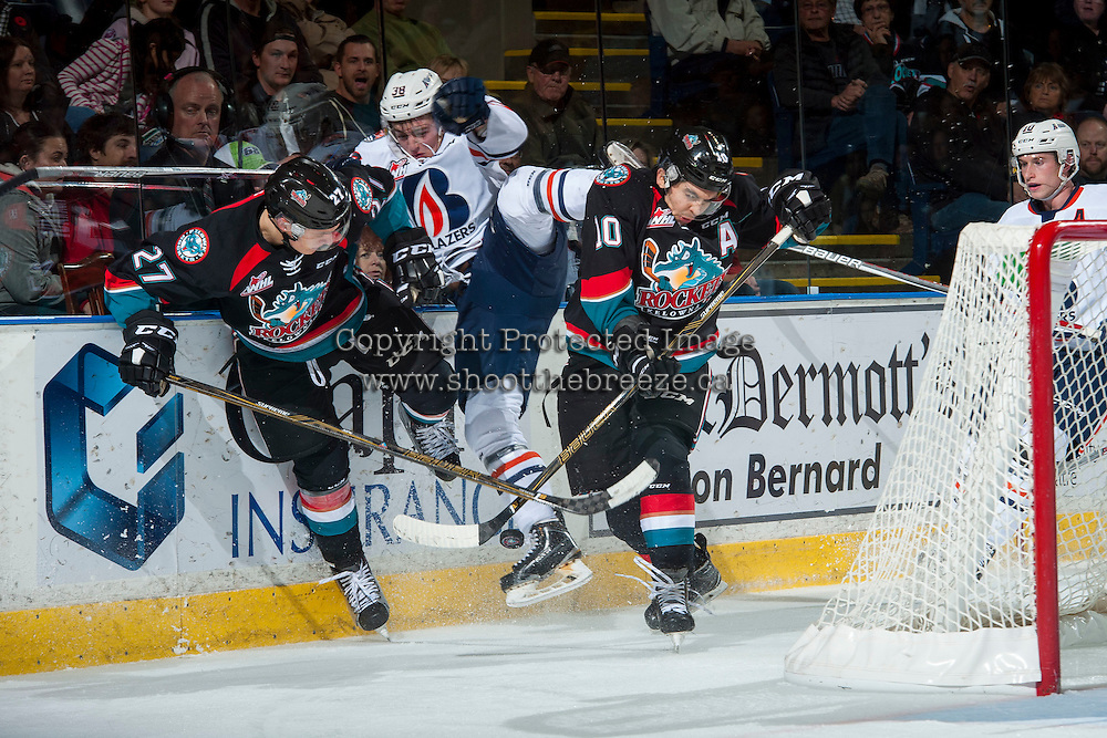 KELOWNA, CANADA - NOVEMBER 1: Calvin Thurkauf #27 and Nick Merkley #10 of the Kelowna Rockets check Dawson Davidson #38 of the Kamloops Blazers into the boards behind the net during second period on November 1, 2016 at Prospera Place in Kelowna, British Columbia, Canada.  (Photo by Marissa Baecker/Shoot the Breeze)  *** Local Caption ***
