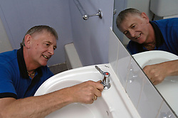 Housing Association plumber fixing tap UK