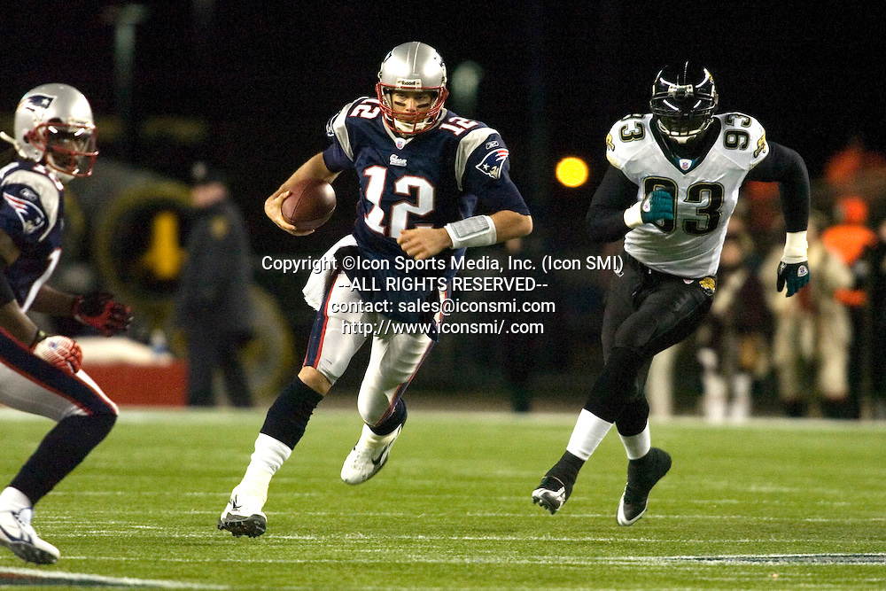 12 January 2008:   Patriot Quarterback Tom Brady (12) with a first quarter run as the New England Patriots defeated the Jacksonville Jaguars 31 to 20 in the AFC Divisional Playoff Game in Gillette Stadium, Foxboro, Massachusetts