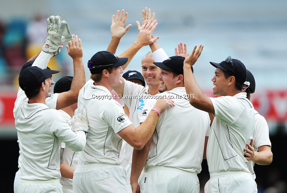 New Zealand bowler Chris Martin celebrates the dismissal of Phillip Hughes, caught Guptill on Day 2 of the first cricket test between Australia and New Zealand Black Caps at the Gabba in Brisbane, Thursday 1 December 2011. Photo: Andrew Cornaga/Photosport.co.nz