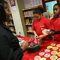 Lauren Wood | Buy at photos.djournal.com<br /> Wilma Bradley picks out an ornament from her granddaughter Milah Boone, 10, right, and her classmate Crissen McCoy, 10, as they and other students participate in the CLAUS Project Thursday afternoon at Lawndale Elementary School. Fifth grade students were raising money for St. Jude.