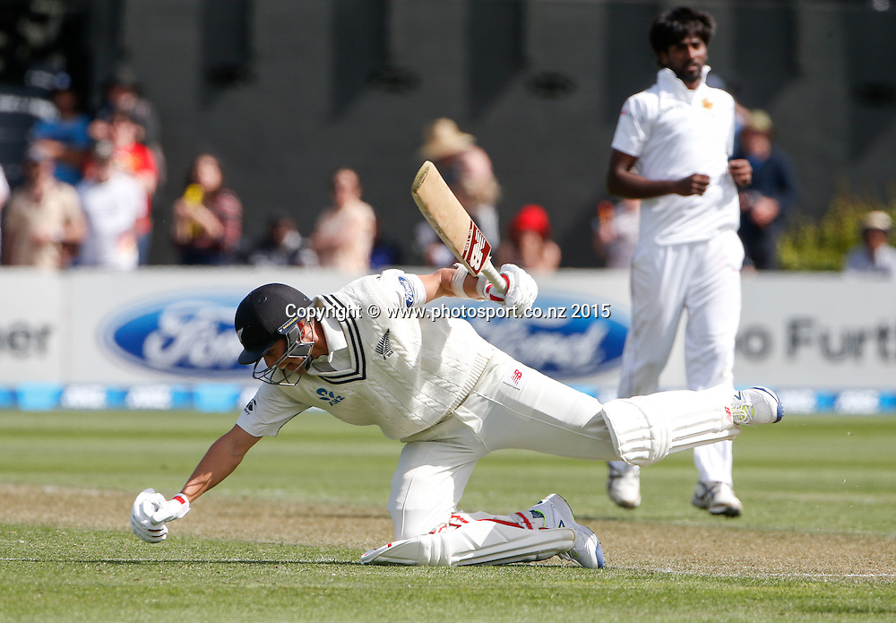 Trent Boult takes a tumble avoiding a bouncer.  First day, second test, ANZ Cricket Test series, New Zealand Black Caps v Sri Lanka, 03 January 2015, Basin Reserve, Wellington, New Zealand. Photo: John Cowpland / www.photosport.co.nz