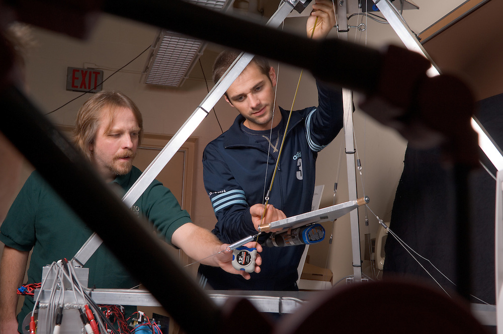17236Mechanical Engineering: Robots: Lab: Electric Bobcat..Robert L. Williams II, Ph.D., Professor and Assistant Chair, Department of Mechanical Engineering, Russ College of Engineering & Technology works with Michele Castagnini, a mechanical enginering international student from Italy.