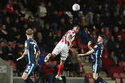 Adam Thompson, Tyrone Barnett and Jordan Rossiter   during the EFL Sky Bet League 2 match between Cheltenham Town and Bury at LCI Rail Stadium, Cheltenham, England on 5 March 2019.
