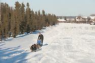 Photographs of John Baker's 2011 Iditarod run. Leaving Kaltag. Stephen Nowers/Alaska Dispatch.