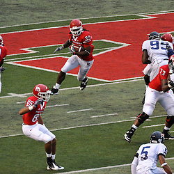 Sep 12, 2009; Piscataway, NJ, USA; Rutgers running back Jourdan Brooks (39) runs through blocks opened by his teammates during the second half of Rutgers' 45-7 victory over Howard in NCAA college football at Rutgers Stadium