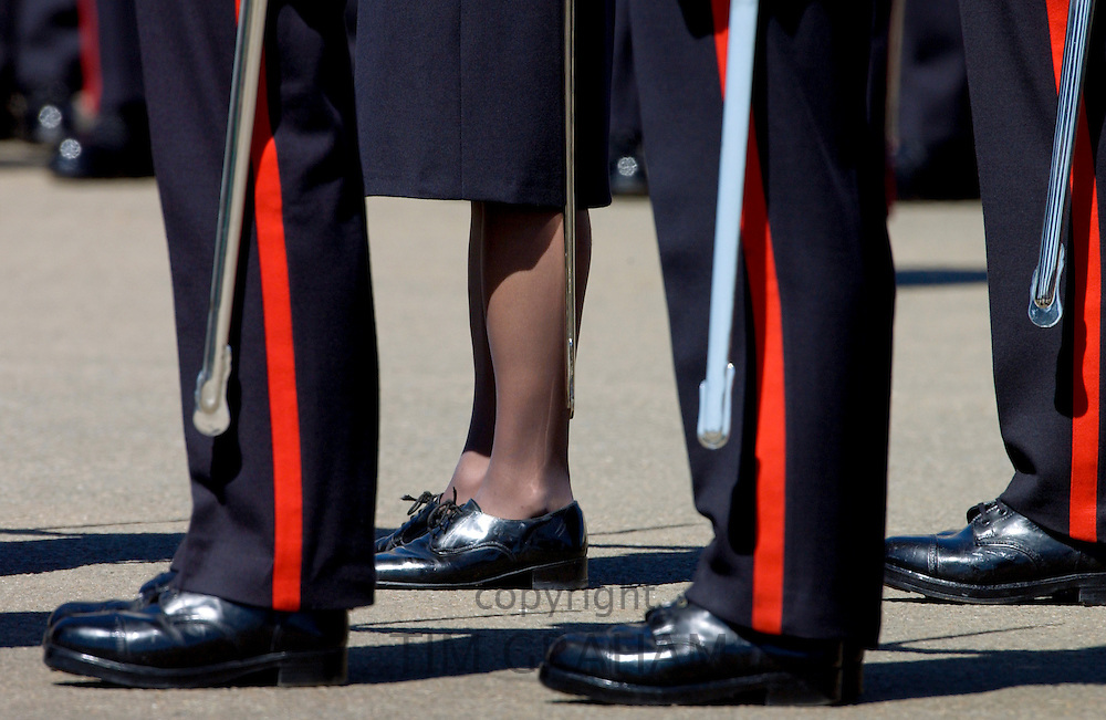 One woman among male soldiers in military dress uniform with shiny hobnail boots on parade at Sandhurst Military Academy