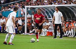 July 31, 2018 - Miami Gardens, Florida, USA - Manchester United F.C. forward Alexis Sanchez (7) moves the ball during an International Champions Cup match between Real Madrid C.F. and Manchester United F.C. at the Hard Rock Stadium in Miami Gardens, Florida. Manchester United F.C. won the game 2-1. (Credit Image: © Mario Houben via ZUMA Wire)