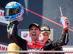 February 25, 2018 - Melbourne, Victoria, Australia - Italian rider Marco Melandri (#33) of Aruba.it Racing - Ducati celebrates on the podium after winning the second race on day 3 of the opening round of the 2018 World Superbike season at the Phillip Island circuit in Phillip Island, Australia. (Credit Image: © Theo Karanikos via ZUMA Wire)