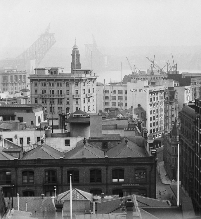 The New Bridge under construction from the roof of the State Savings Bank, Sydney, Australia, 1930