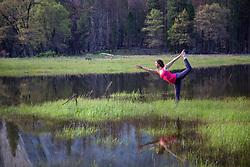 May 4, 2017 - Woman practicing yoga tree pose by lake in Yosemite National Park, California, USA (Credit Image: © Brian Holstein/Image Source via ZUMA Press)