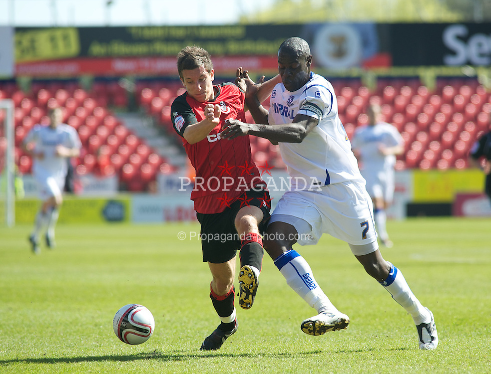 BOURNEMOUTH, ENGLAND - Saturday, April 9, 2011: Tranmere Rovers' Enoch Showunmi and Bournemouth's Marc Pugh in action during the Football League One match at the Dean Court Stadium. (Photo by Gareth Davies/Propaganda)