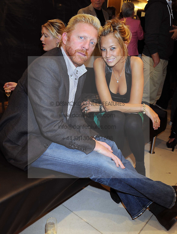 BORIS BECKER and his fiancé SANDY MEYER-WOLDEN at the Form Menswear launch at Harrod's, London on 2nd October 2008.