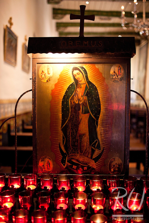 Prayer Candles and Virgin Mary Painting in Serra Chapel, Mission San Juan Capistrano, California