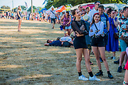 The queue to get into the main arean forms early as Danny Boyle has asked for extras for his latest film - The 2018 Latitude Festival, Henham Park. Suffolk 14 July 2018