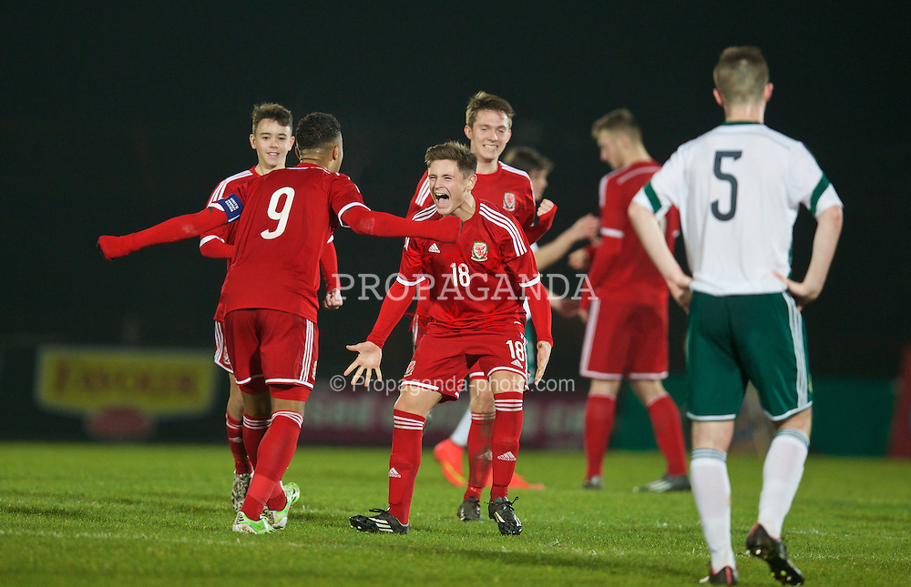 BALLYMENA, NORTHERN IRELAND - Thursday, November 20, 2014: Wales' captain Tyler Roberts and Keiran Evans celebrate after beating Northern Ireland 2-0 and winning the Victory Shield during the Under-16's Victory Shield International match at the Ballymena Showgrounds. (Pic by David Rawcliffe/Propaganda)