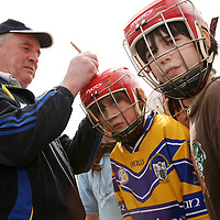Students getting their helmets signed by Clare hurling manager Mike McNamara at the Raheen School hurling launch in Scariff on Wednesday.<br /><br />Photograph by Yvonne Vaughan.