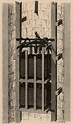 Fontaine's safety cage for mine shafts.   If the rope or chain suspending the cage broke a spring was released and levers were thrust into the guide rods, so stopping the cage from plunging to the bottom of the shaft.  From 'Underground Life; or, Mines and Miners' by Louis Simonin (London, 1869). Wood engraving.