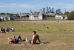 © Licensed to London News Pictures. 11/09/2016. LONDON, UK.  People enjoying the hot, sunny autumn weather and the city of London skyline in Greenwich Park, south east London today.  Photo credit: Vickie Flores/LNP