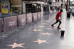 March 19, 2020, Hollywood, California, USA: With no tourists or crowds to perform for along Hollywood Blvd, JONTE FLORENCE works on his moves near Hollywood and Highland Thursday. The coronavirus has closed restaurants, stores, theaters and many commuters are now working from home. (Credit Image: © David Crane/Orange County Register via ZUMA Wire)