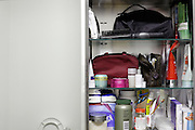 open medicine cabinet with mirror in domestic toilet room