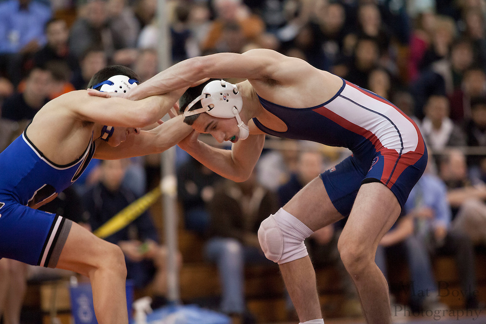 John Amato of Timber Creek High School defeats Anthony Racobaldo of Williamstown High School, by decision 3-2, in the District 30 Wrestling 113lb weight class final at Overbrook High School on February 18, 2012. (photo / Mat Boyle)