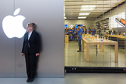 © Licensed to London News Pictures. 19/09/2014. A security guard stands out the front of the Apple store ahead of the release of the iphone 6 at the Apple Store in Chadstone Melbourne Australia. Australia is one of the first countries in the world to sell the iphone 6 due to geographic location & time zone. Photo credit : Asanka Brendon Ratnayake/LNP