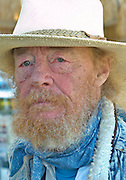 senior citizen ,rugged looks,blue eyes,red skin,rummy,bearded,red hair,white hair and blue scarve