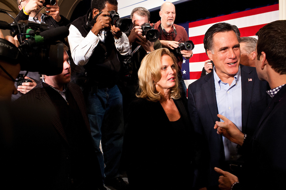 Republican presidential candidate Mitt Romney, joined by his wife Ann Romney, greets Rep. Aaron Schock (R-IL), right, after a campaign rally on Tuesday, December 27, 2011 in Davenport, IA.