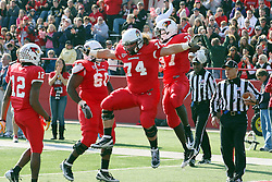 05 November 2011:  Darrelynn Dunn is given the jumping body bump in celebration of a td by Nick Bledsoe during an NCAA football game between the Western Illinois Leathernecks and the Illinois State Redbirds at Hancock Stadium in Normal IL