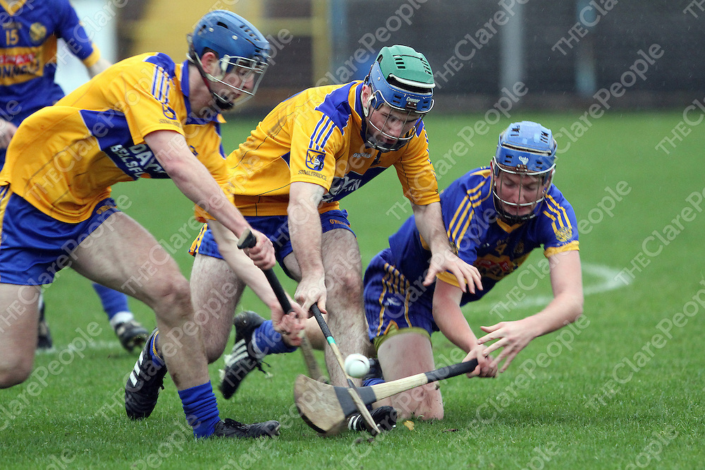 Newmarket's Shane Cusack battles for possession with Kevin Lynch & Noel Purcell Sixmilebridge in the Minor A Hurling FInal. - Photograph by Flann Howard