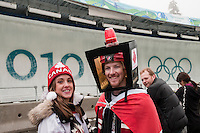 A fan from Canada wears a hockey score board on his head at the 4-man bobsleigh finals during the 2010 Olympic Winter Games in Whistler, BC Canada.