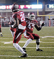 Arkansas Razorbacks safety Rohan Gaines (26) intercepts a pass and returns it for a touchdown against Ole Miss at Donald W. Reynolds Razorback Stadium in Fayetteville, Ark. on Saturday, November 22, 2014. Arkansas won 30-0.