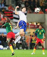 CAPE TOWN, SOUTH AFRICA- Thursday 24 June 2010, Mark van Bommel chests the ball away from Landry Nguemo during the match between the Netherlands (Holland) and Cameroon held at the new Cape Town Stadium in Green Point during the 2010 FIFA World Cup..Photo by Roger Sedres/Image SA