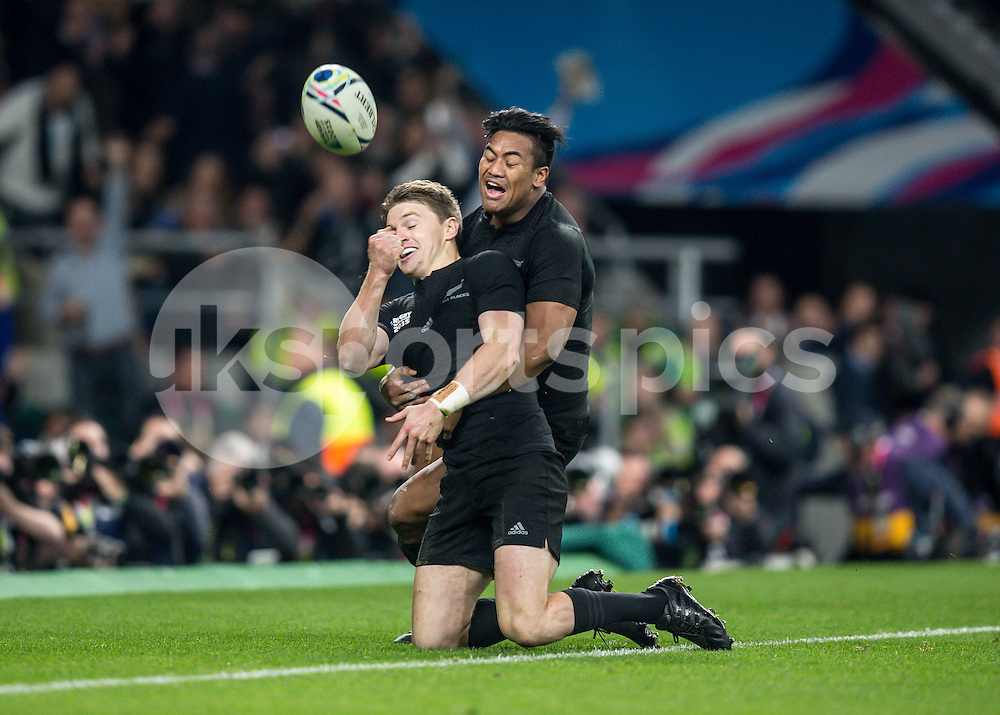 Beauden Barrett of New Zealand celebrates scoring his try with Sonny Bill Williams of New Zealand during the Rugby World Cup Final match between New Zealand and Australia played at Twickenham Stadium, London on the 31st of October 2015. Photo by Liam McAvoy