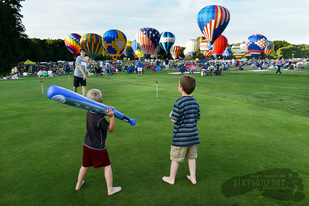 Photo by Gary Cosby Jr.     Isaac Tillman throws to Briston Adams and Mckelly Lynch on the putting green of the driving range as they wait for the balloon glow to begin during the Alabama Jubilee Saturday evening in Point Mallard Park.
